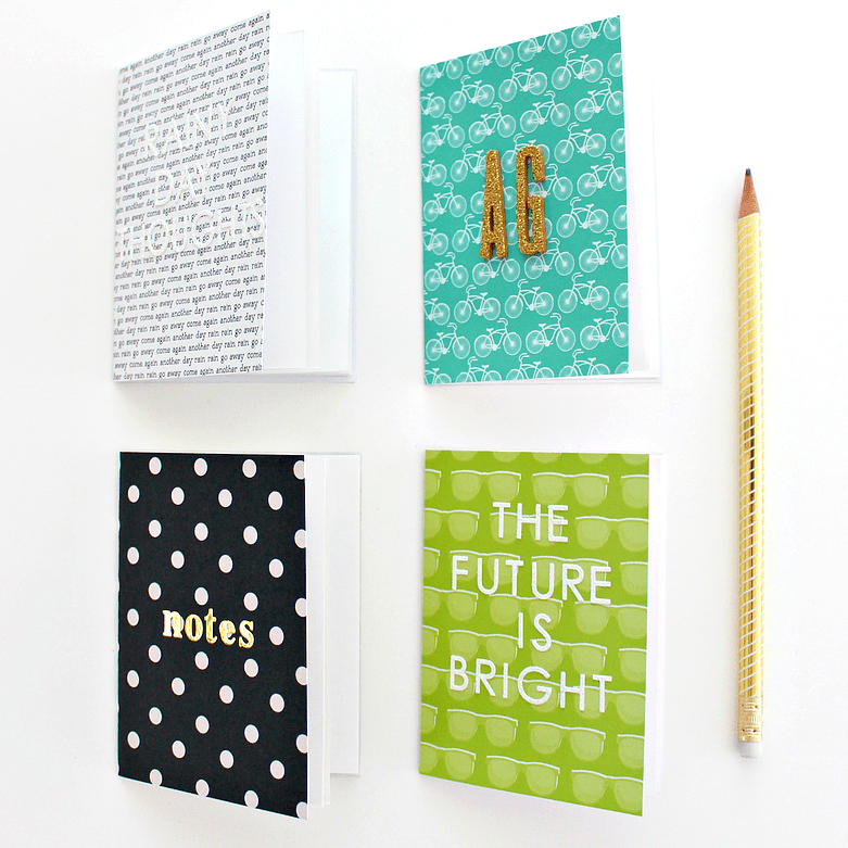 four decorated notebooks