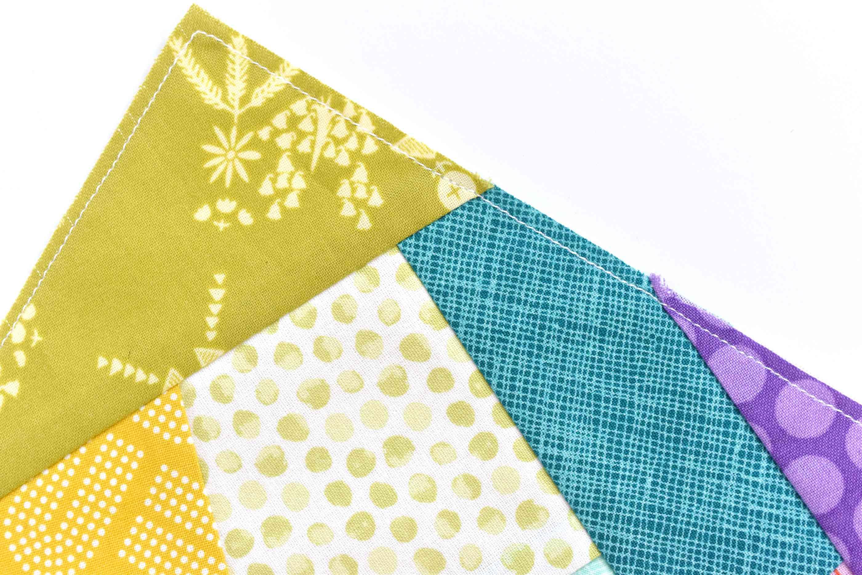 A corner edge of a crazy quilt block