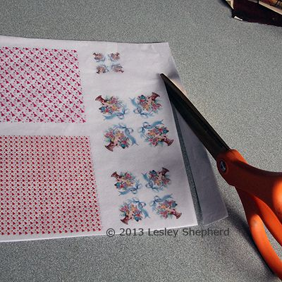 Tissue paper printed on an ink jet printer being cut free from a backing of printer paper