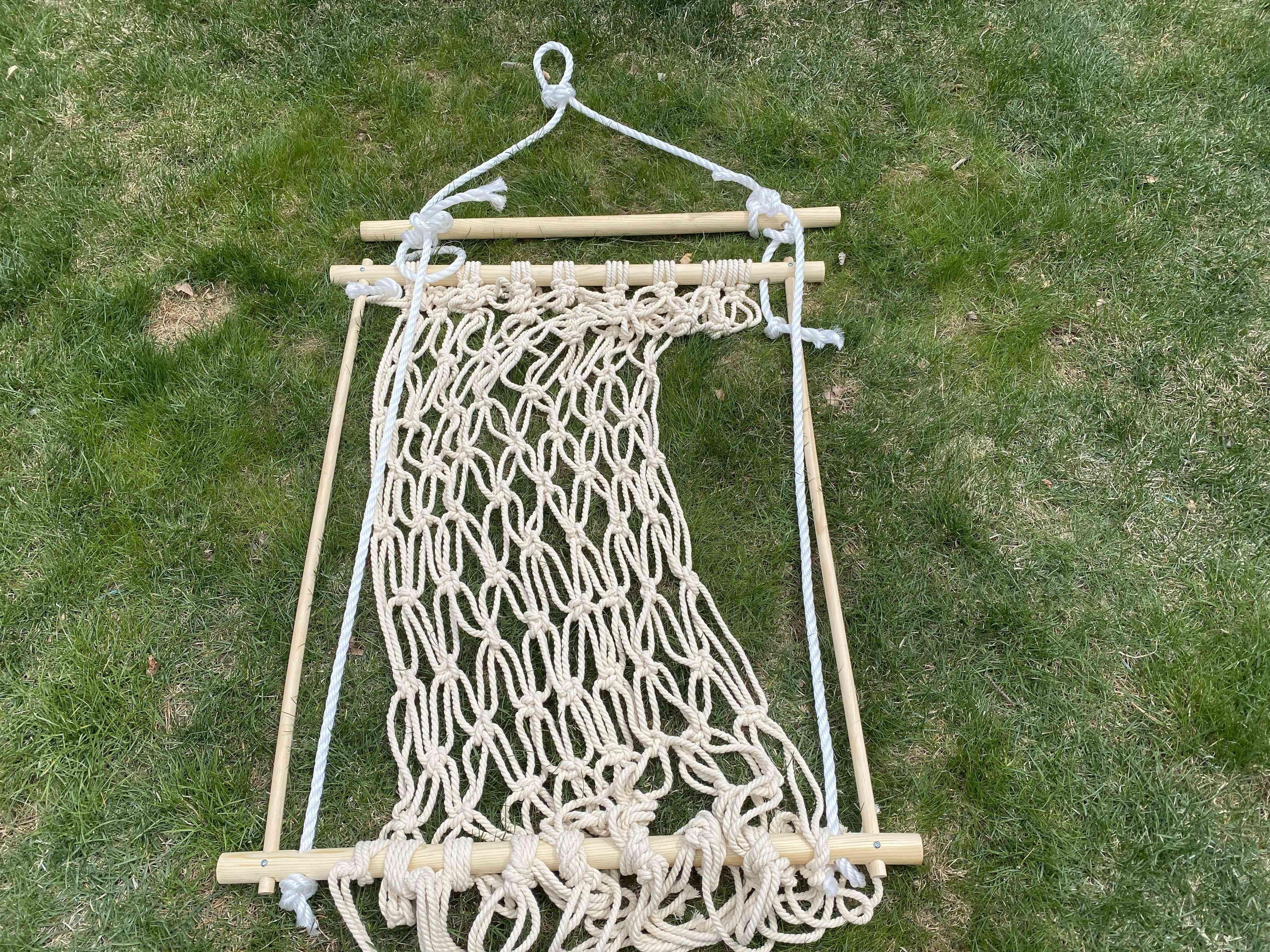 Rope threaded through a macrame chair frame