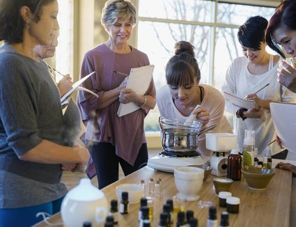 Women with notebooks learning about essential oils
