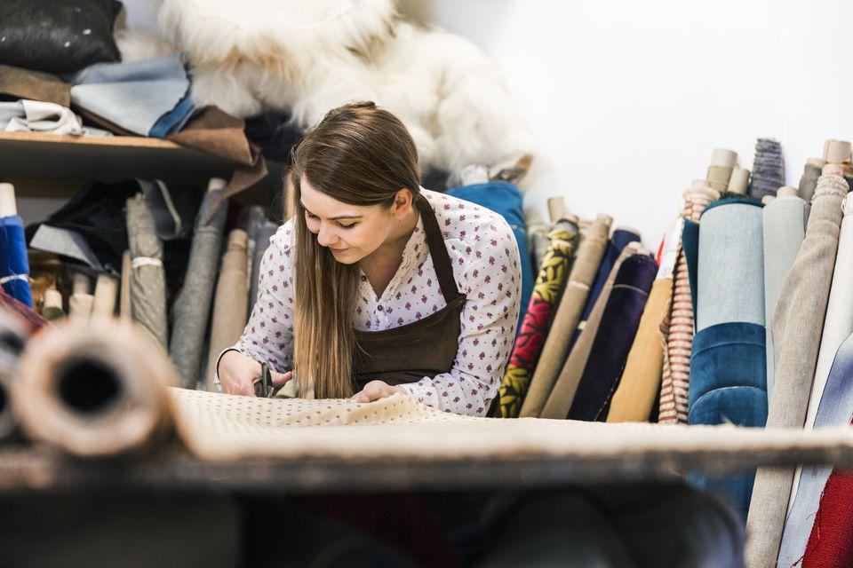 A woman cutting fabrics