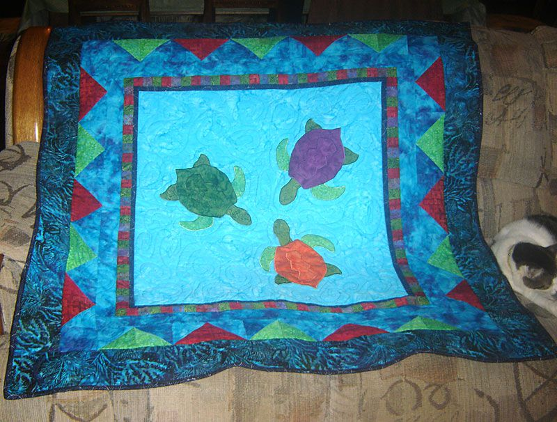 Baby Honu quilt with three sea turtles.