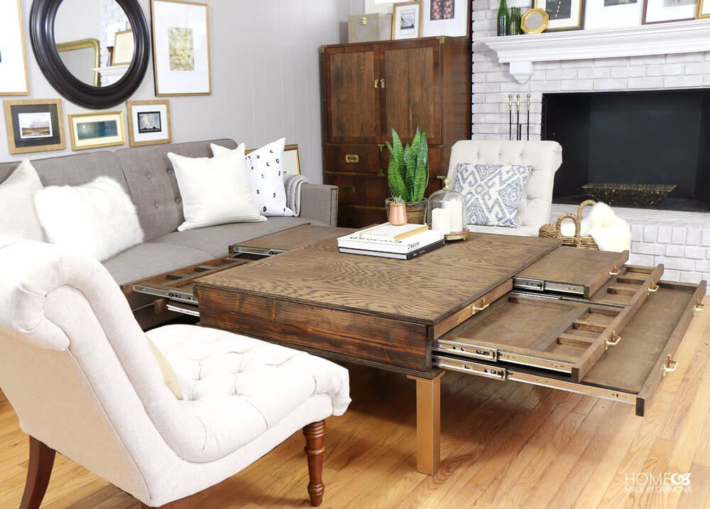 A coffee table with pullouts in a living room