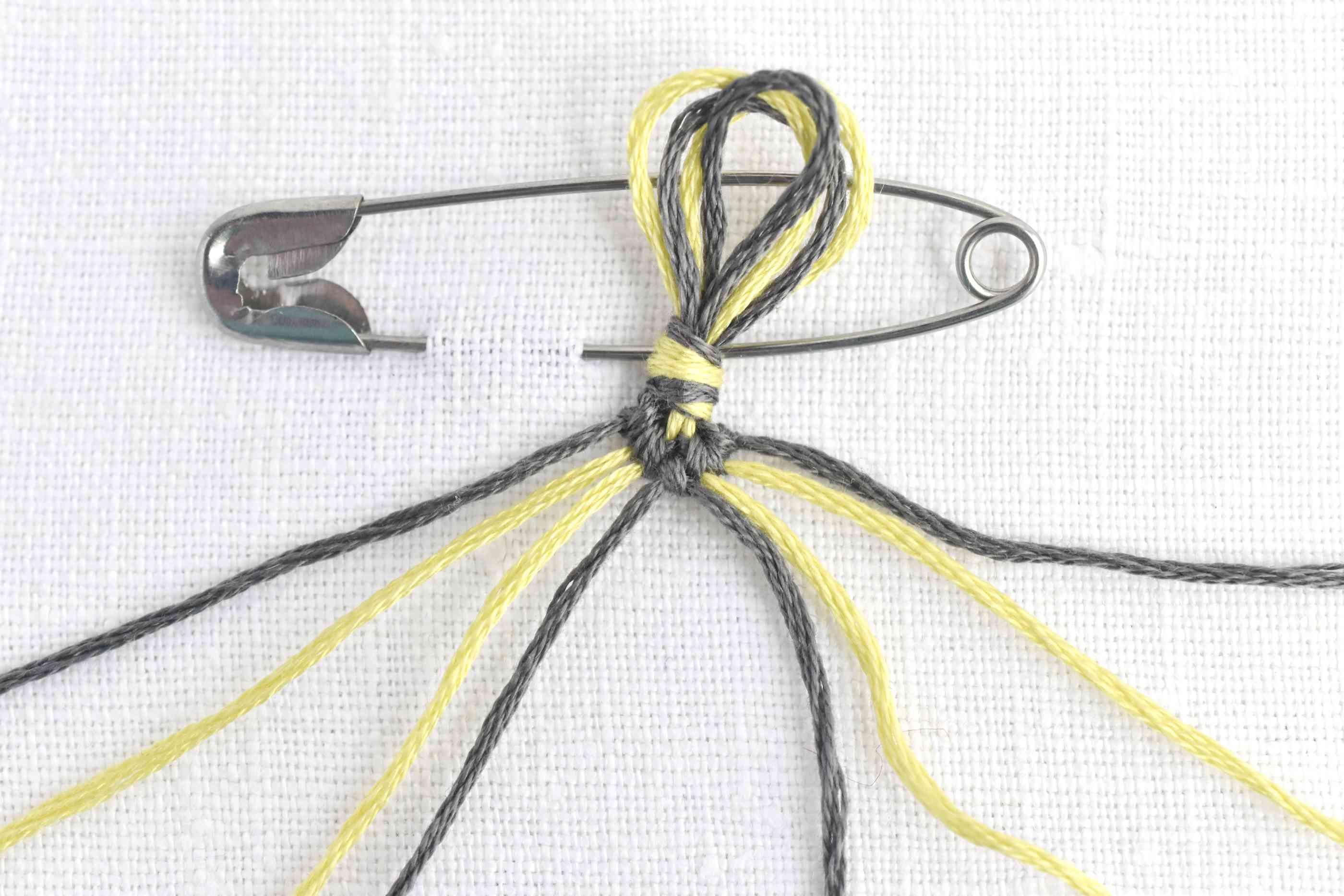 One row of knots on a chevron friendship bracelet