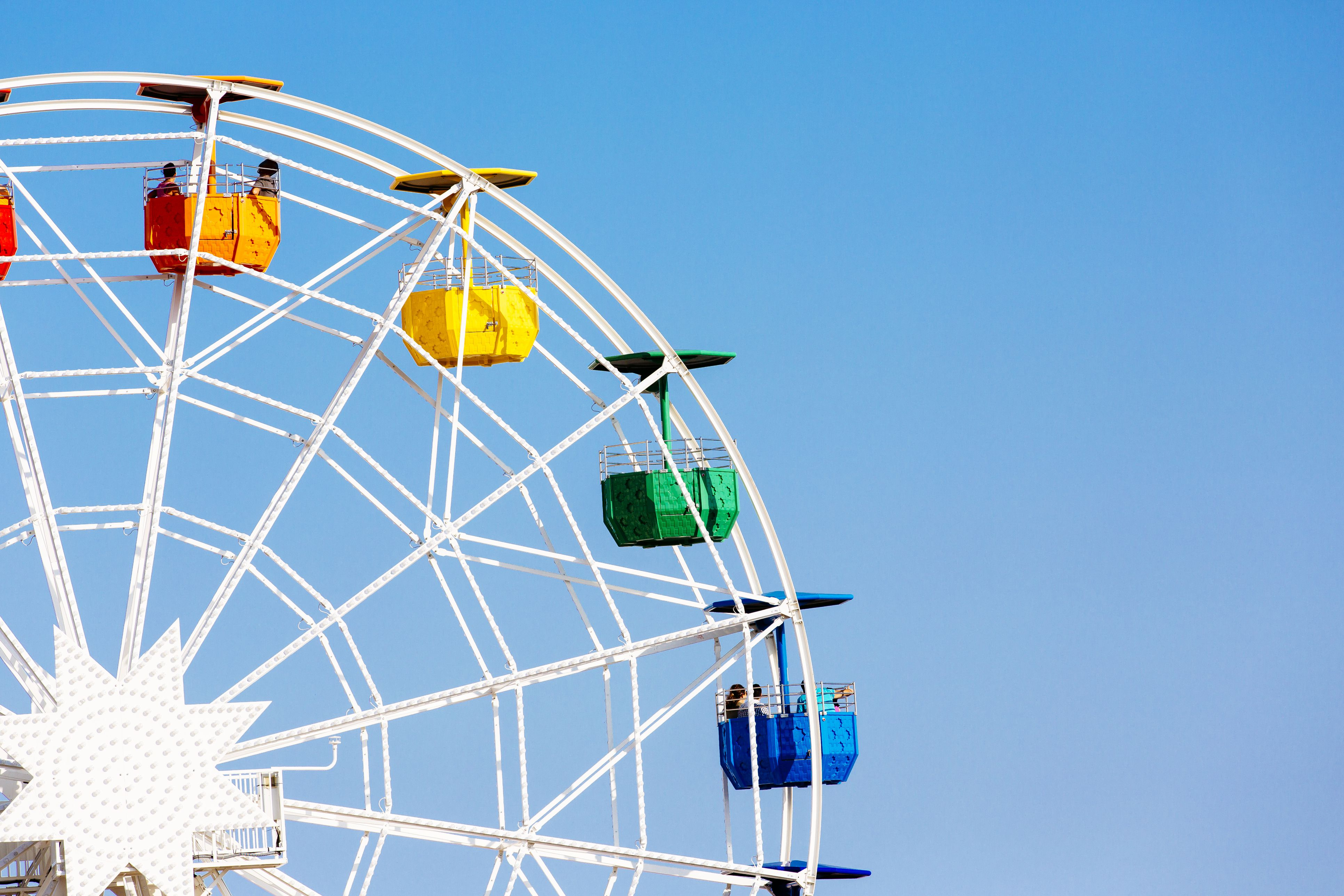 Colorful ferris wheel against clear blue sky