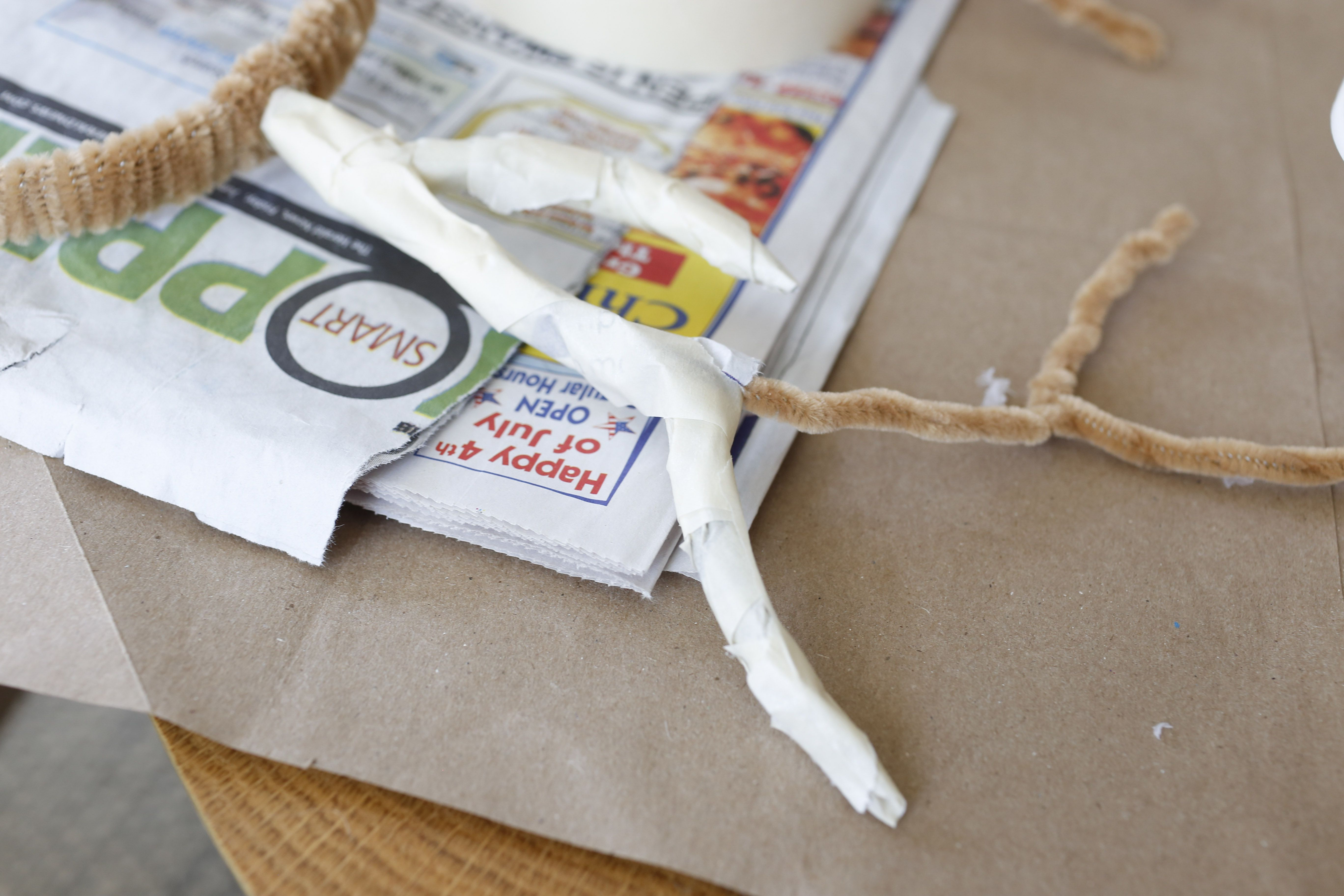 filling antlers with newspaper strips