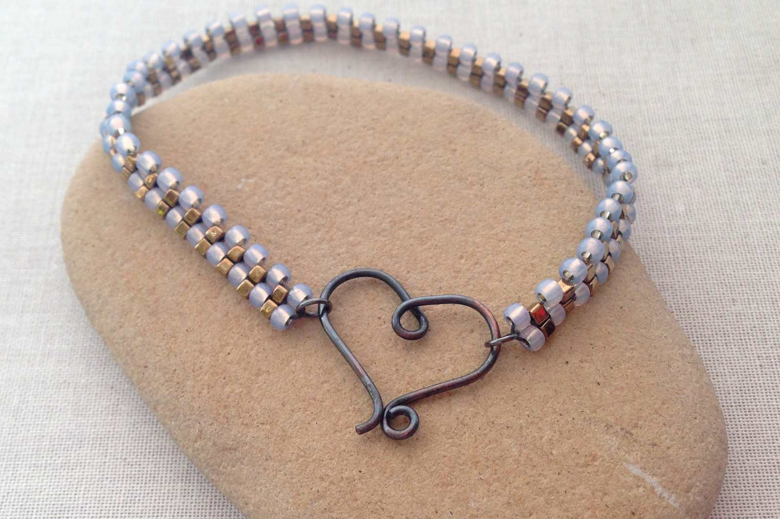 Brick stitch bracelet with handmade heart clasp