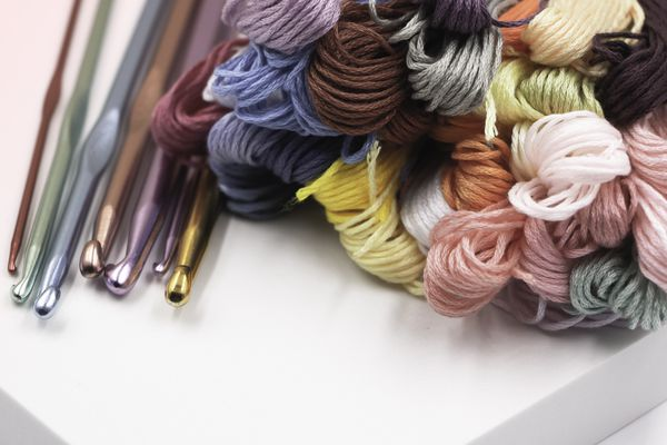 Colorful yarn and crochet hooks