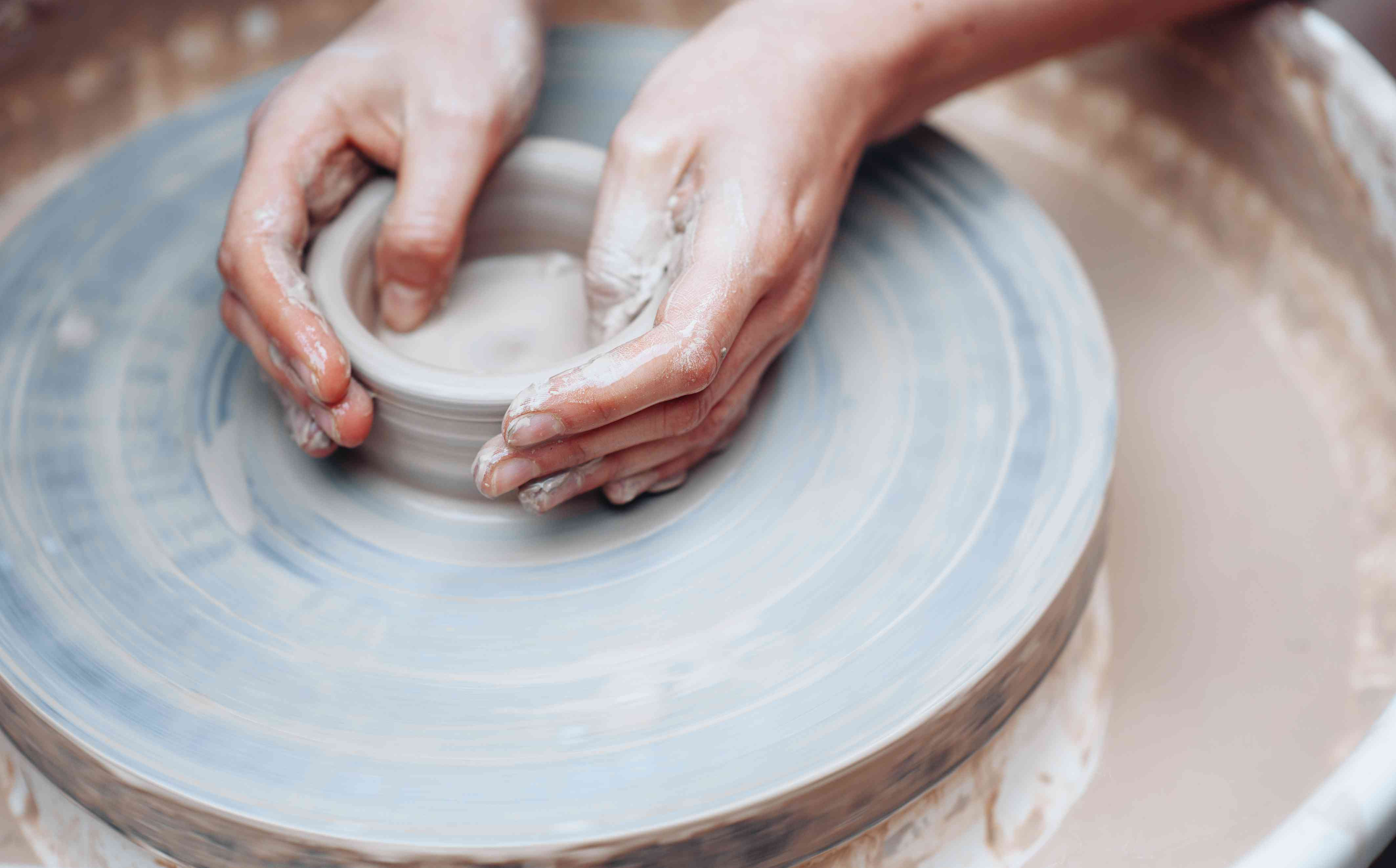 Potters hands on wheel