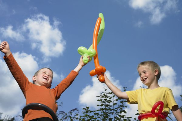 Kids playing with balloon swords