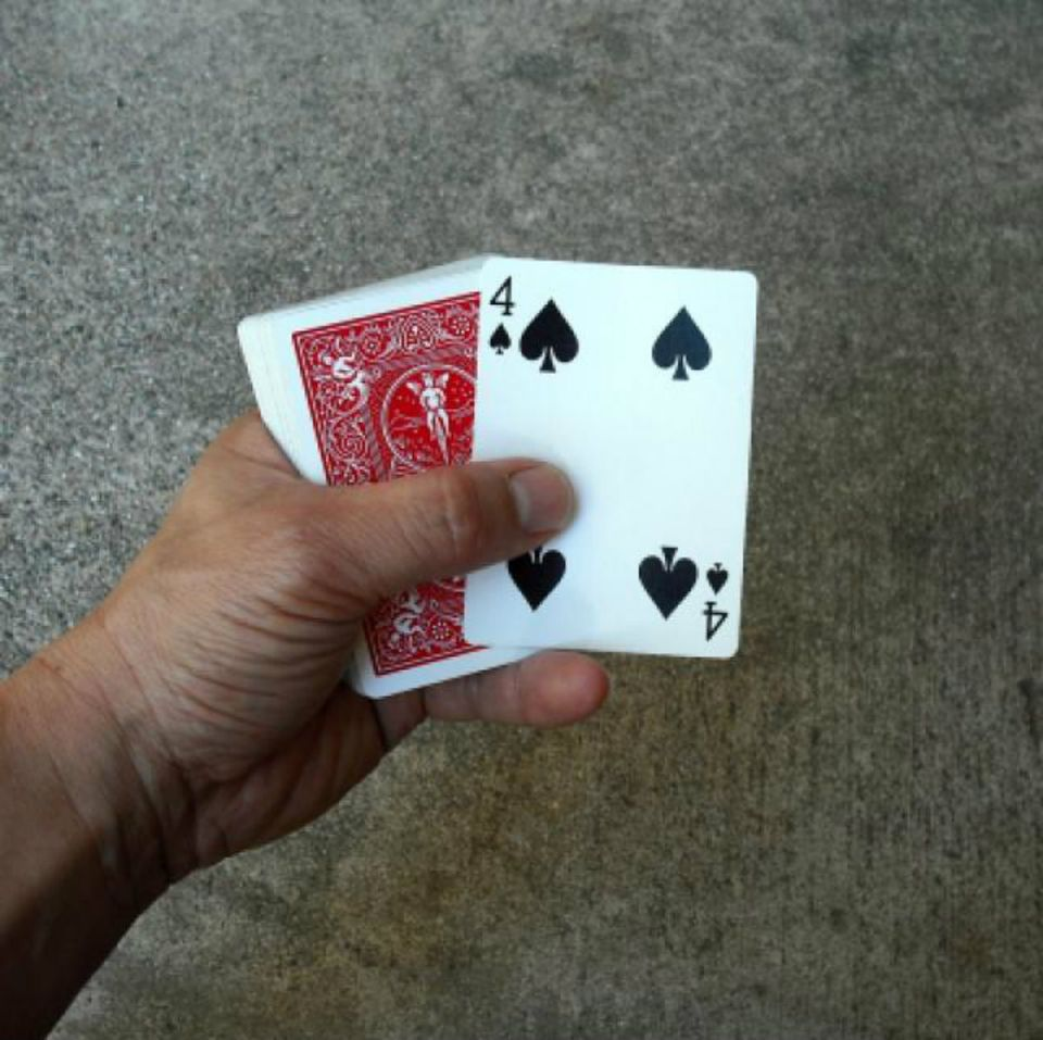 Deck of cards with 4 showing