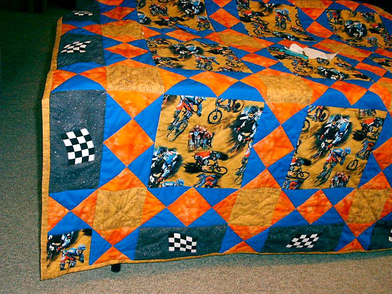 Blue and orange BMX snowball quilt draped over a table.
