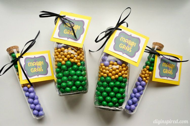 Printable Mardi Gras Tags Tied to Bottles of Candy