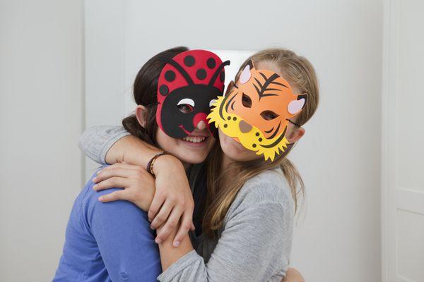 Smiling kids wearing colorful masks