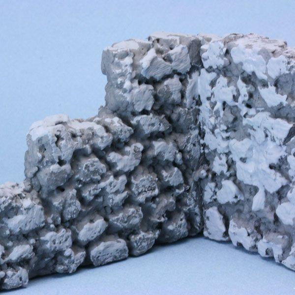 Mid grey coating applied to dark grey faux stone model wall made from styrofoam bead board.