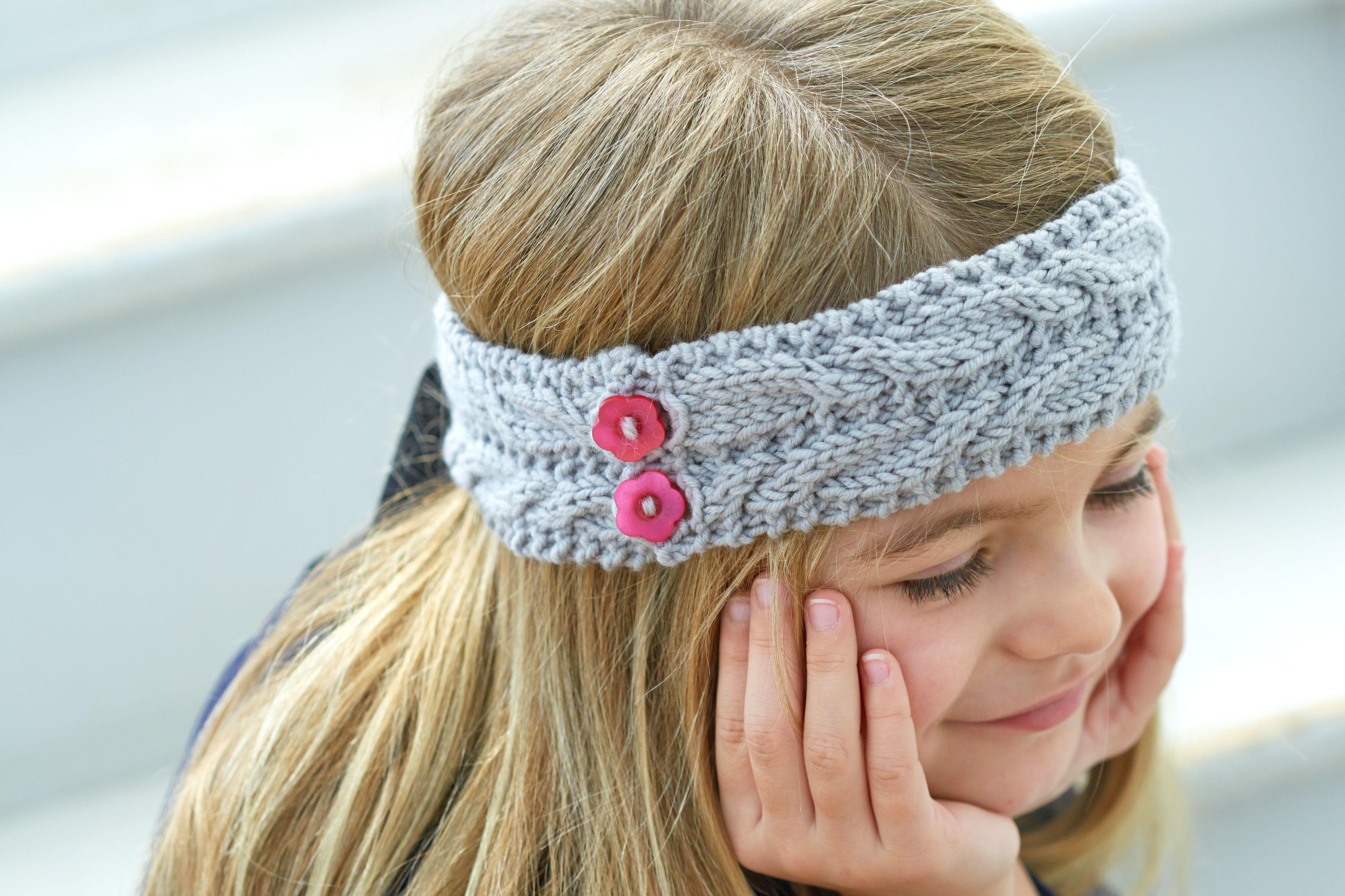 A little girl wearing a braided ear warmer variation