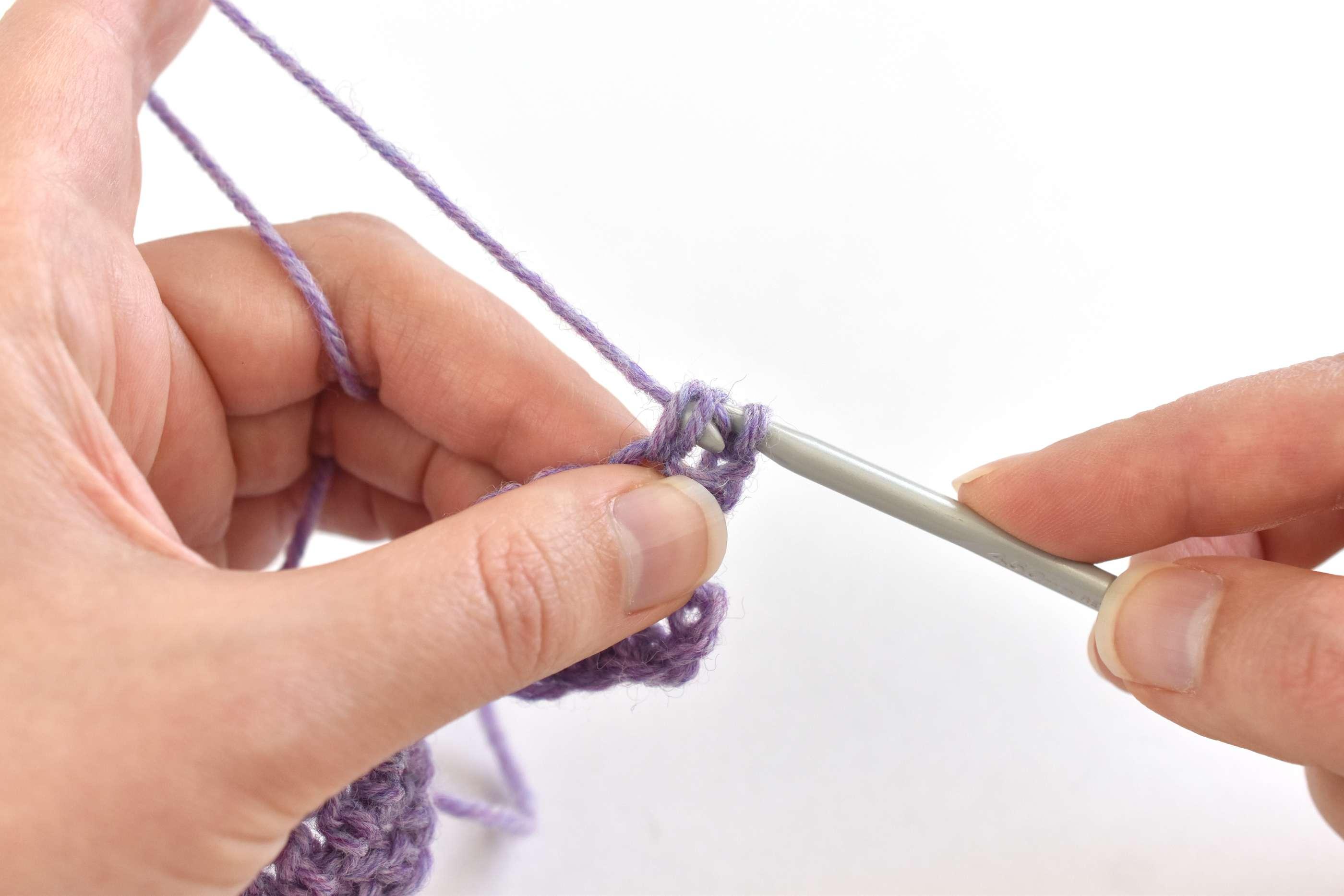 Draw the Yarn Through Two Stitches
