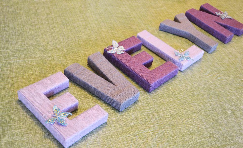 Yarn-wrapped letters nursery wall art