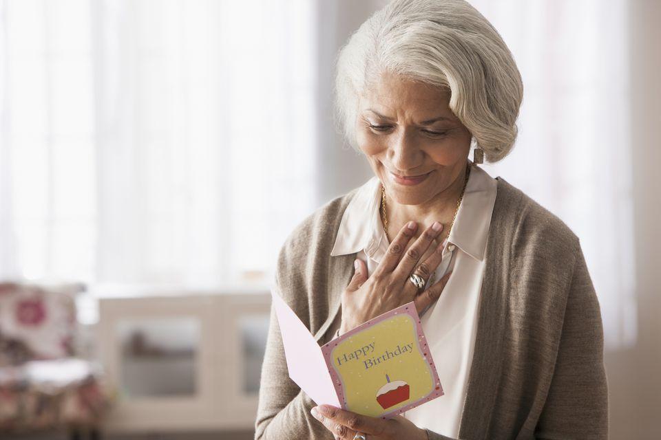 Older woman reading birthday card