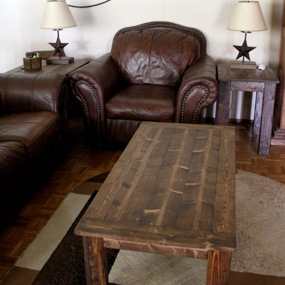 A Wooden Coffee Table In Living Room With Leather Furniture