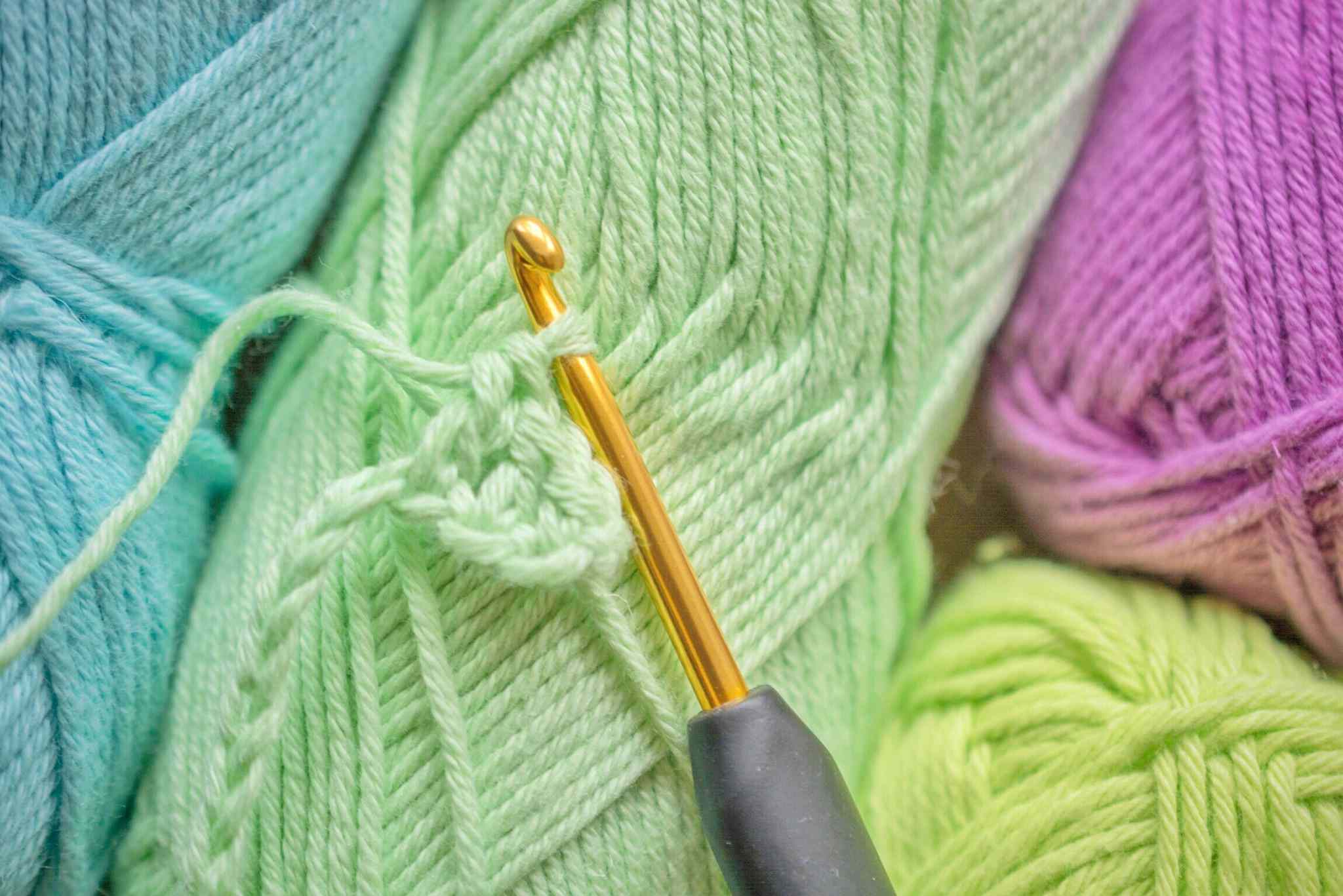 Close-Up Of Crocheting And Wool