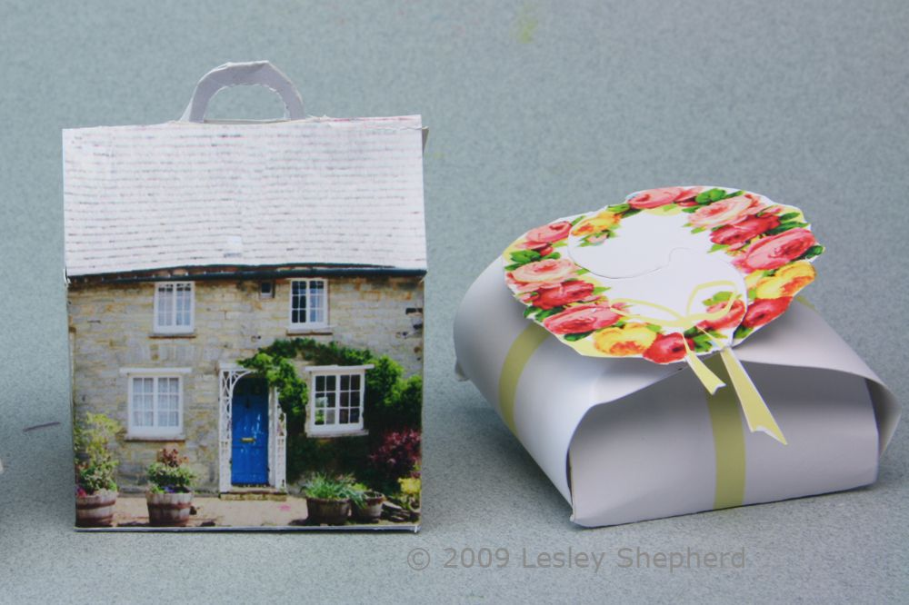 Free printable favor and gift boxes designed with rose garlands or as a stone cottage.