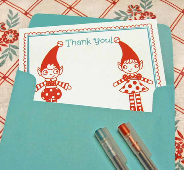 A Christmas thank you card with two red elves on the front.