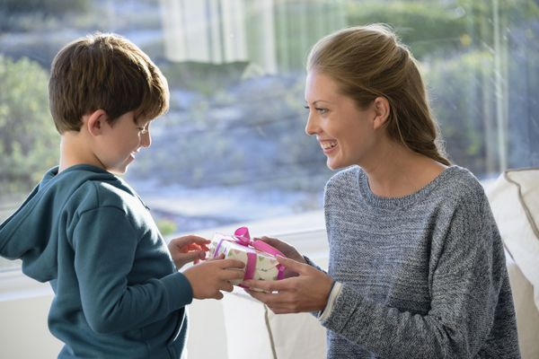 Happy mother and son with birthday gift