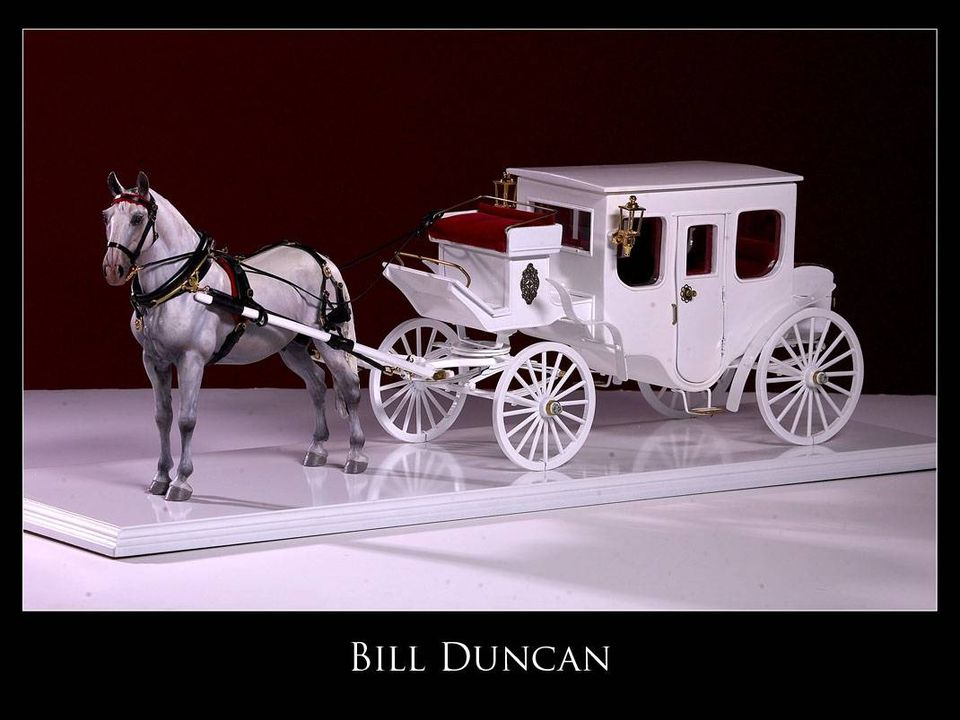 One of a kind hand made model horse carriage.