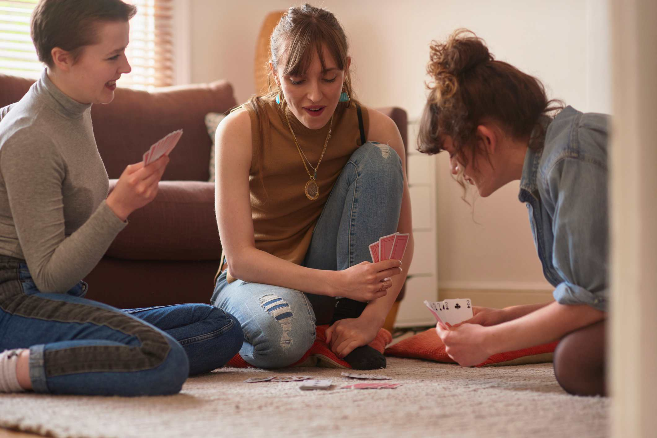 Friends playing cards in living room