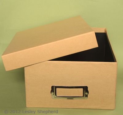Commercial photo storage box with lid useful as a quick container for a diorama