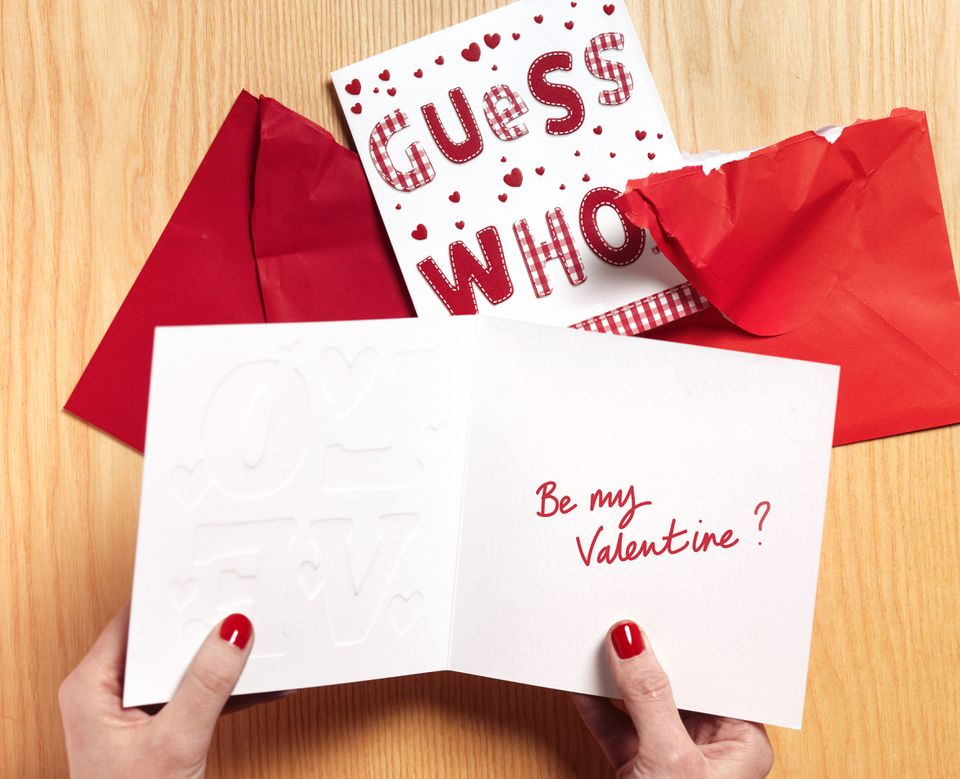 Woman reading valentine card