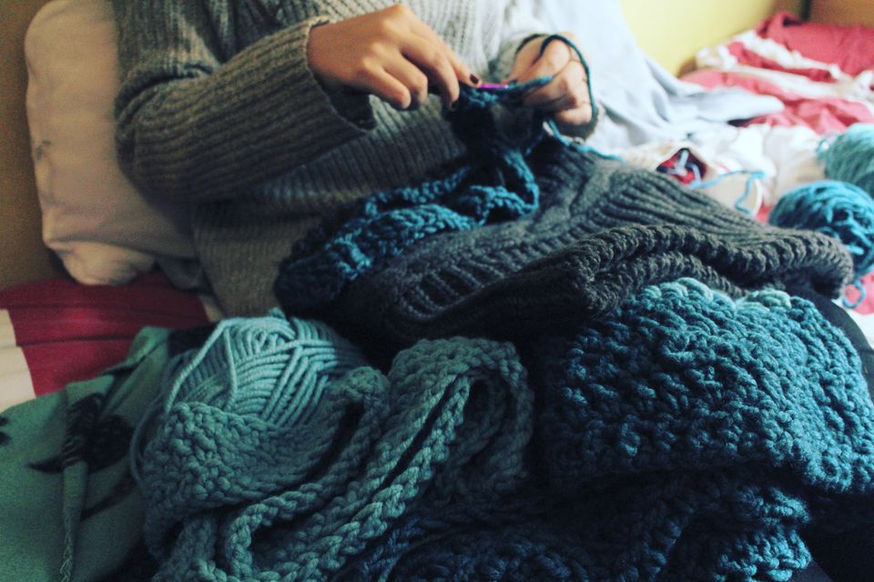 close-up of woman knitting blue pieces