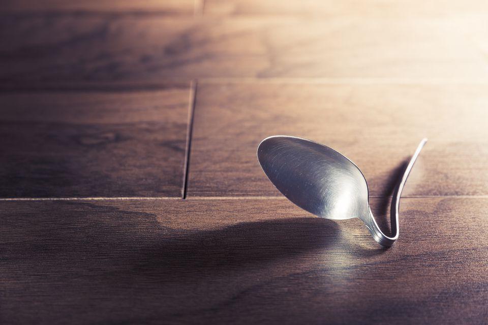 psychokinesis concept with bent spoon