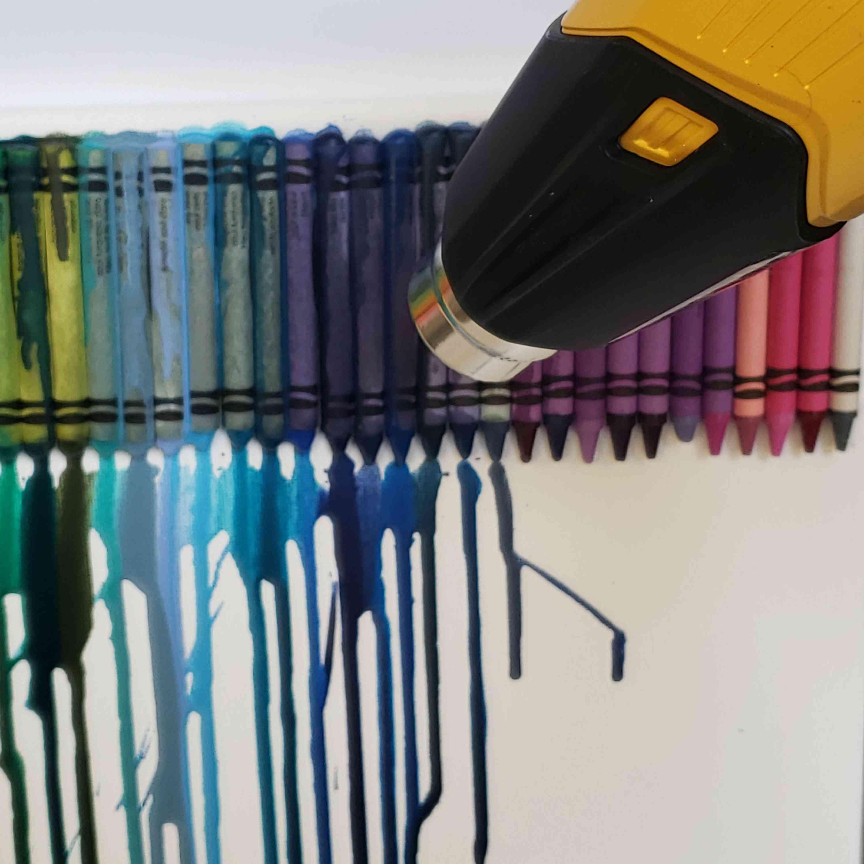 Closeup of heat gun melting crayons