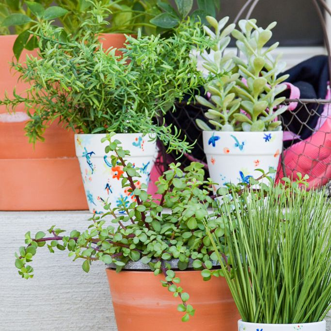 terracotta pots painted white with floral print