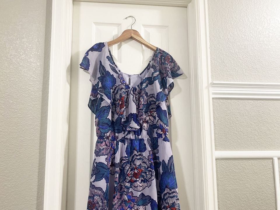 A dress hanging on a door