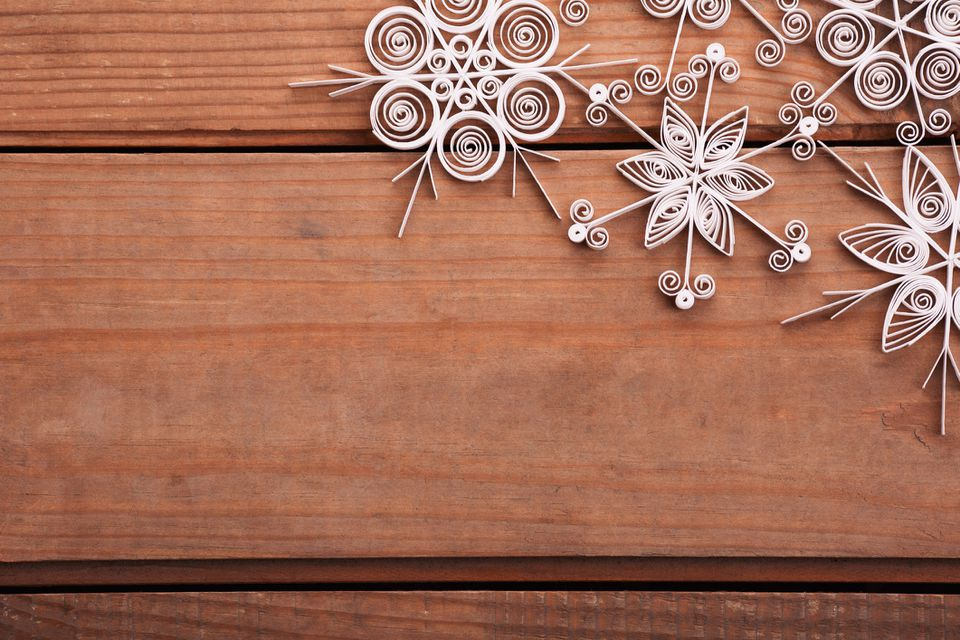Paper snowflakes made with quilling technique