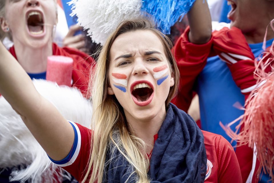 woman cheering, face paint