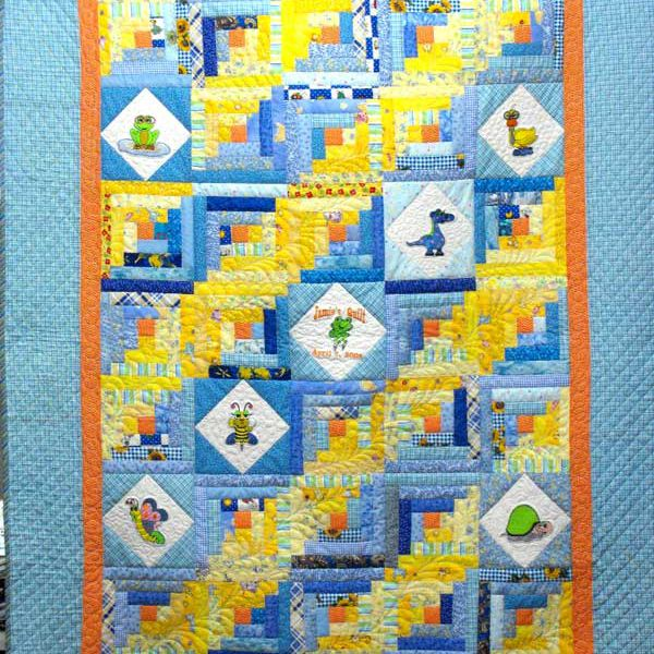 Blue and yellow quilt with baby animals.