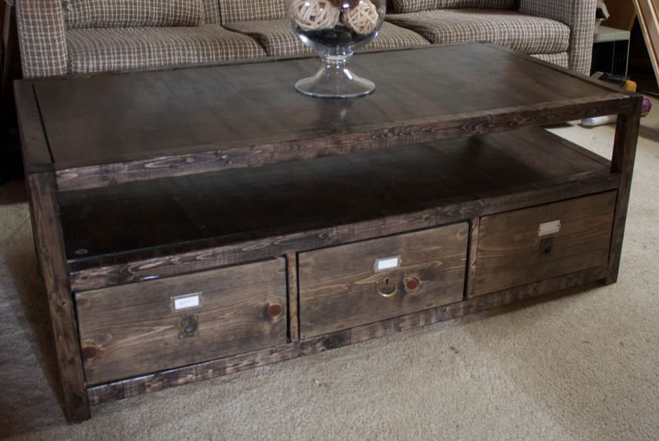 A Coffee Table With Three Drawers
