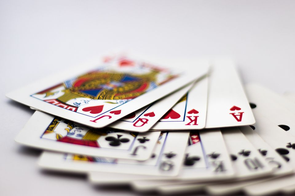Playing Cards fanned out: Suit of Spades, Clubs and Diamonds fanned out over white background. Gambling, Poker, Win, Lose, Chance, Gambling, Money, Red, Black, Jack, Queen, King