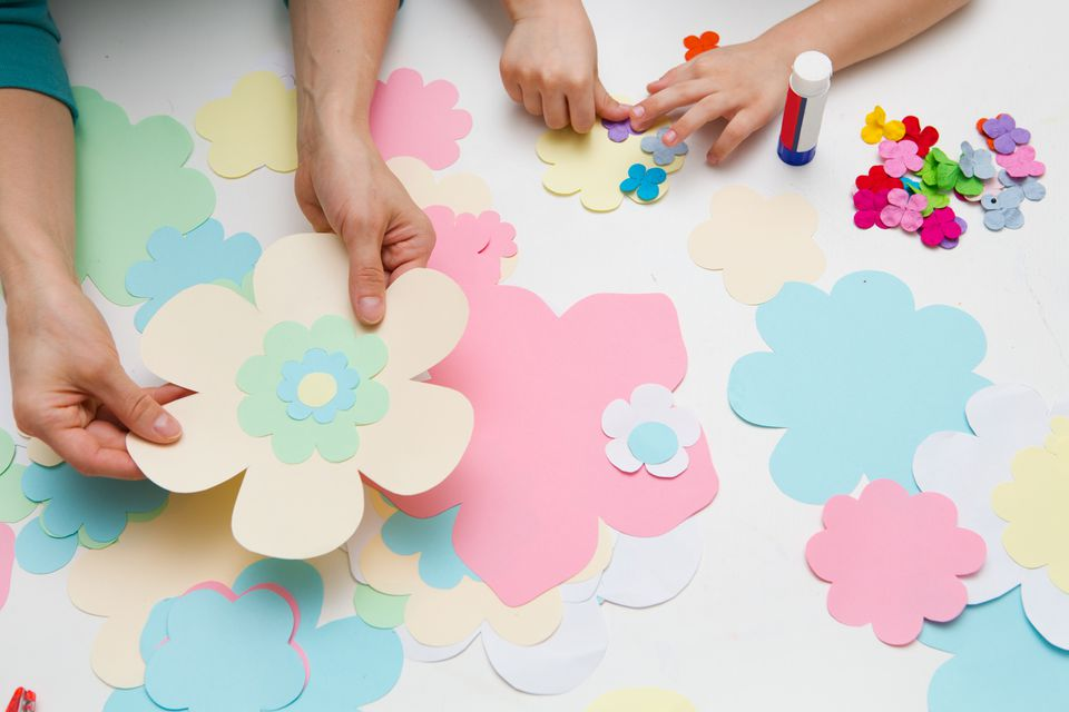 Parent and child making paper flowers
