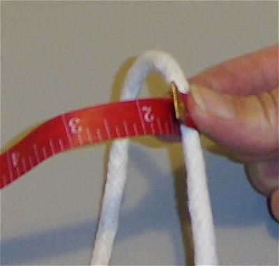 A photo showing a tape measure measuring cording that will be covered