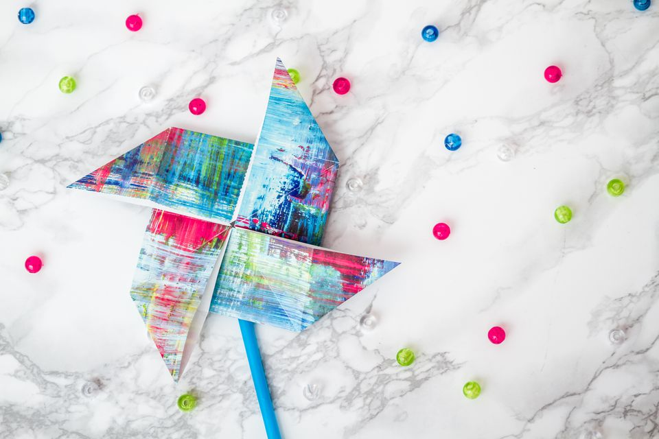 close up of colorful origami pinwheel