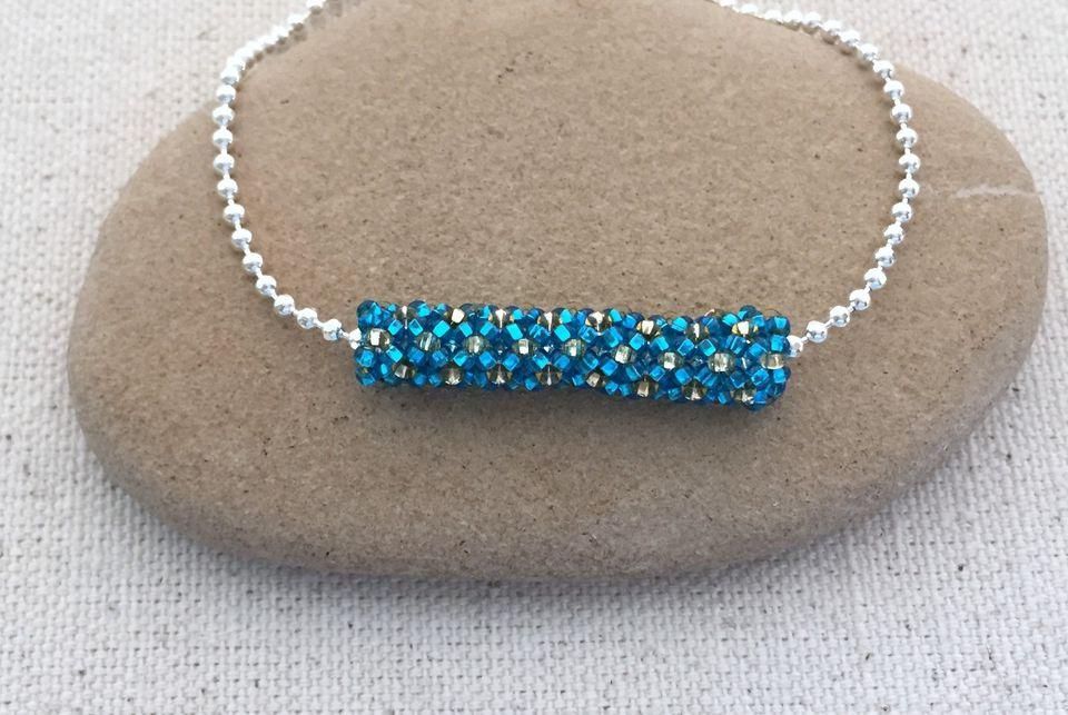 Tubular netting bead on a ball chain