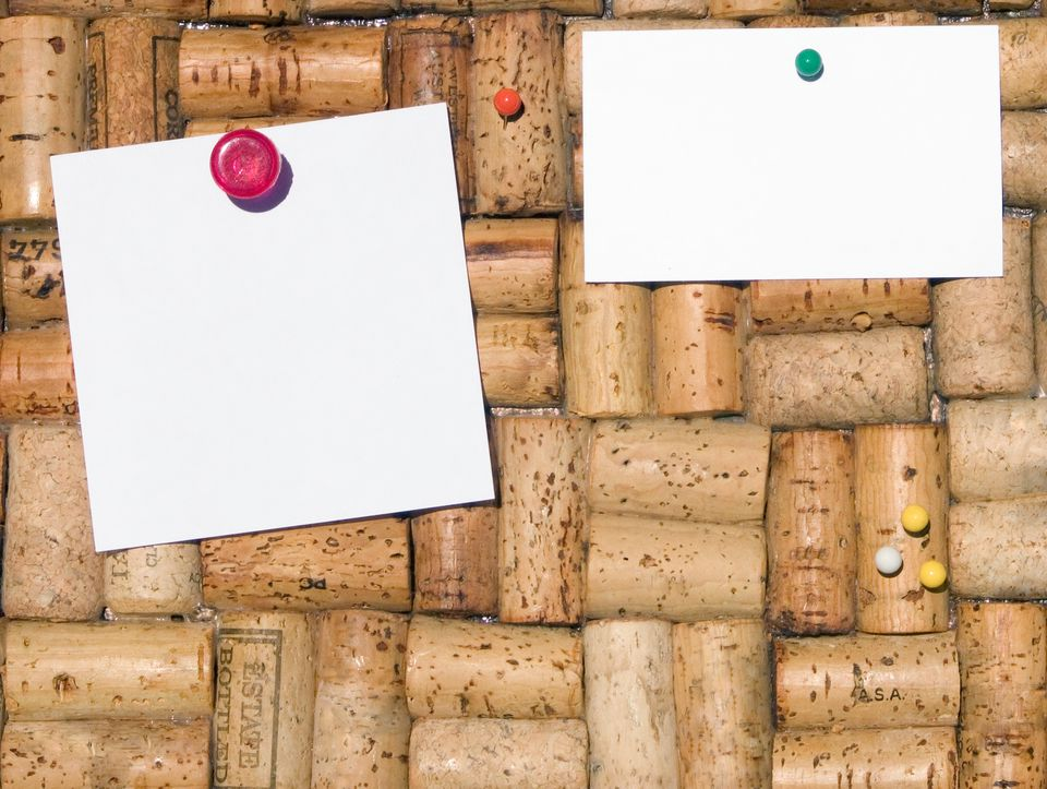 Pinboard with blank note and business card