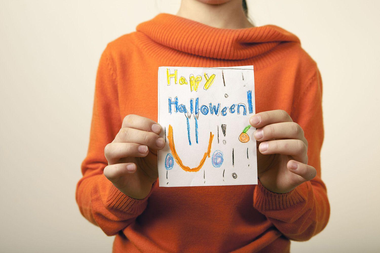 Girl Holding Hand Made Halloween Card