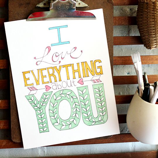 """A colored sign that says """"I Love Everything About You""""."""